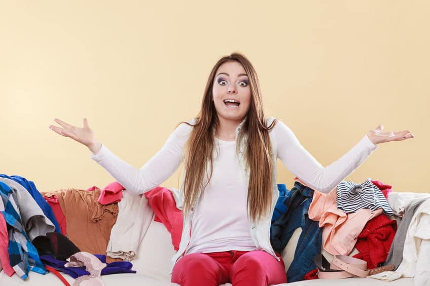 woman shrug shoulders laundry