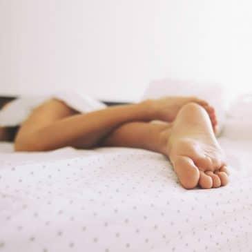 woman feet bed