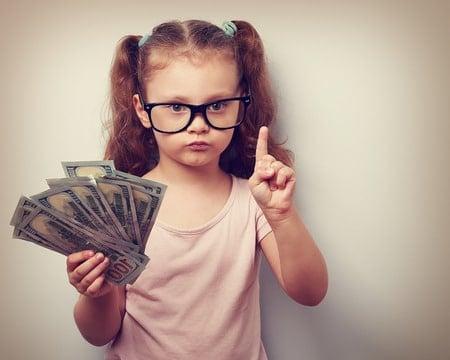 little girl holding money