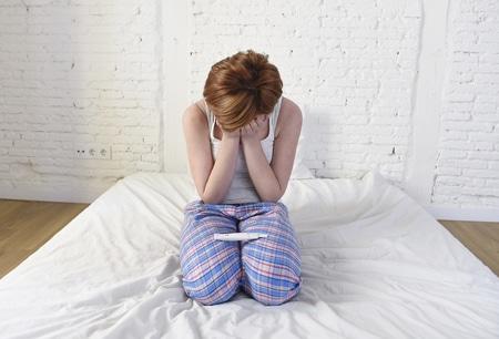 woman not pregnant sad