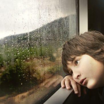 little boy window rain