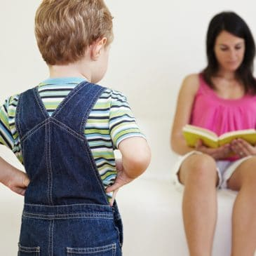 woman read while kid is waiting