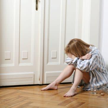 woman burnout sit on the floor