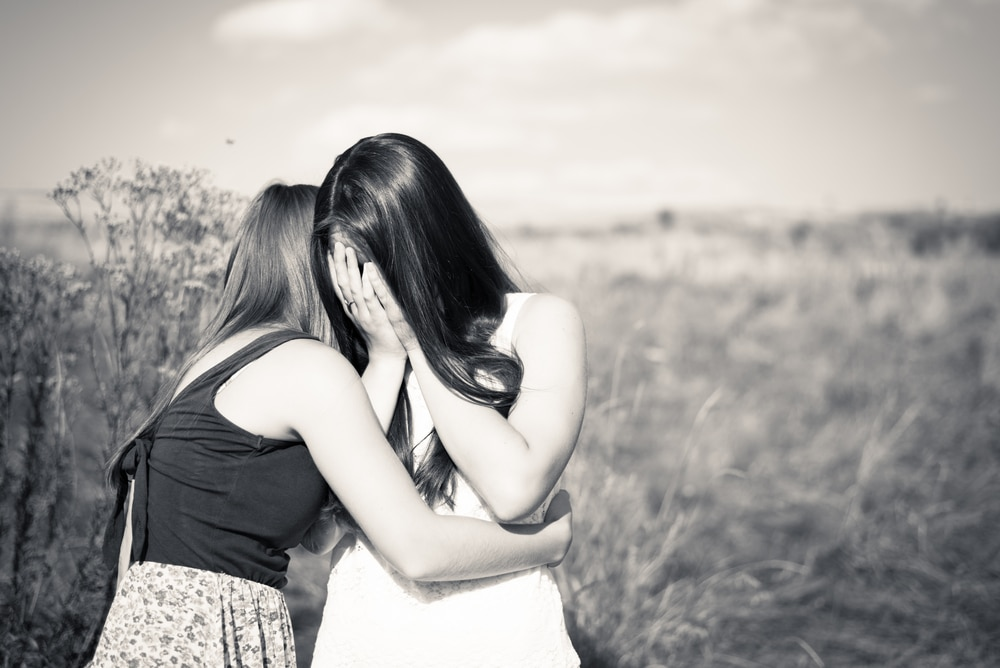 two women friends crying