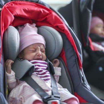 newborn crying in carseat