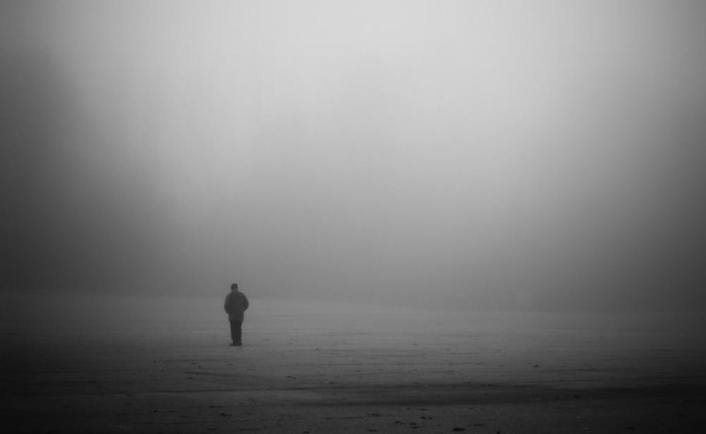man alone in fog