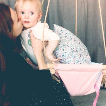 mother kiss baby goodbye