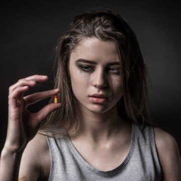 woman depressed take pills