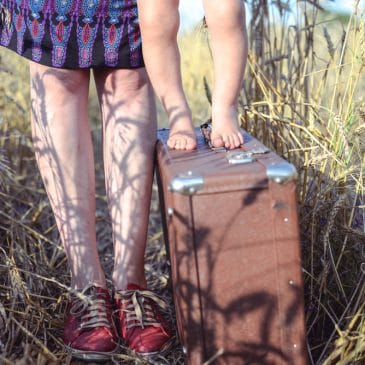 baby woman legs and suitcase
