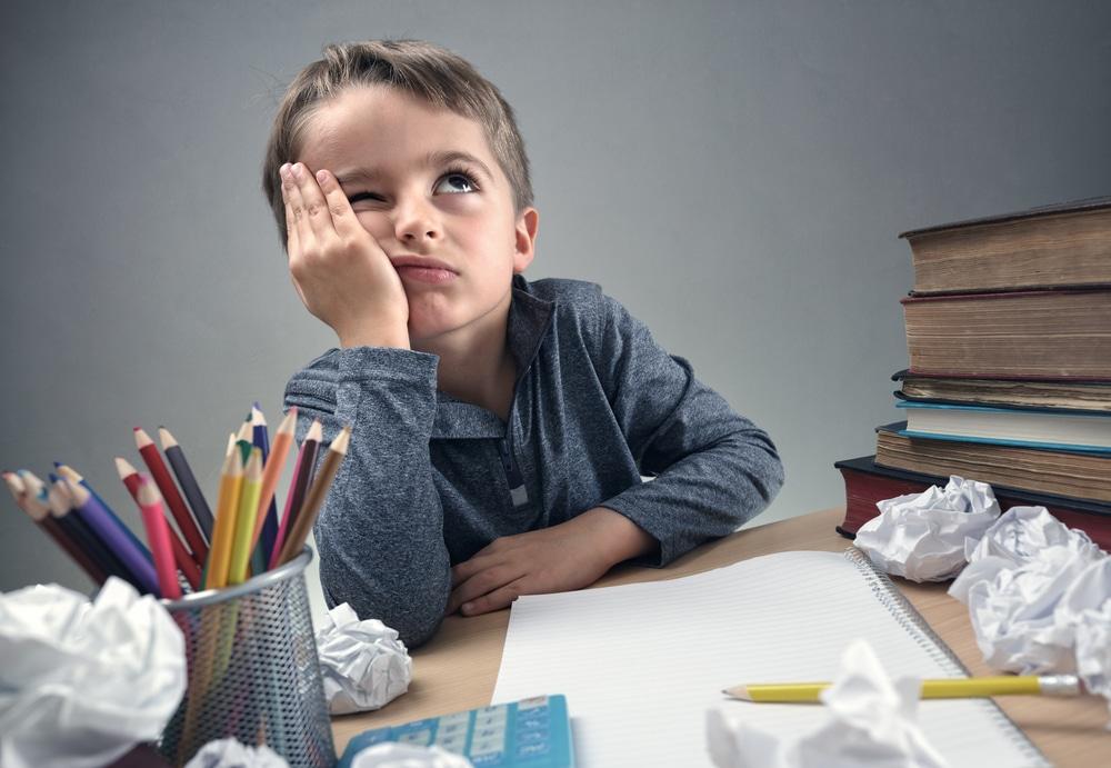 kid doing homeworks