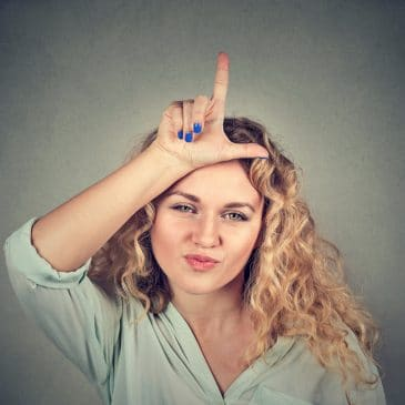 woman loser sign