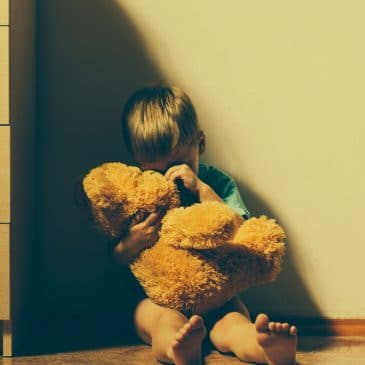 kid crying on the floor with bear