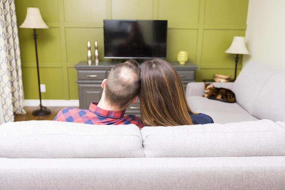 man woman watching tv