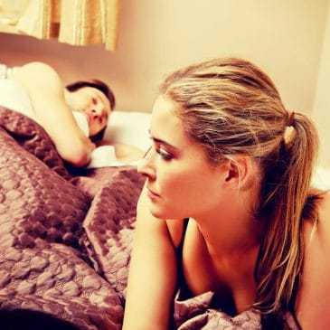woman unhappy man sleeping