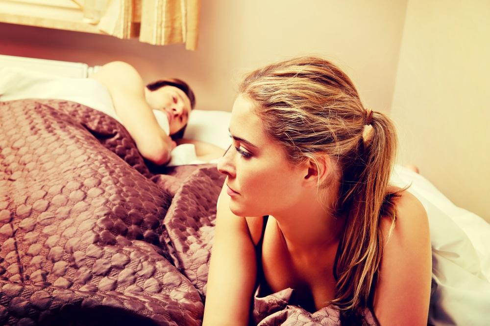 woman unhappy man sleeping