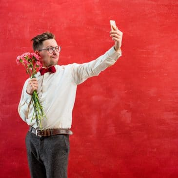 man with flowers and phone