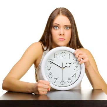 woman with clock angry