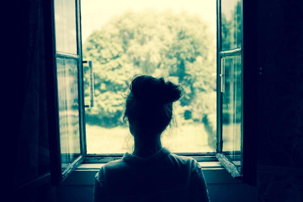 woman looking windows back