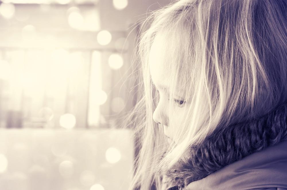 girl sad looking window