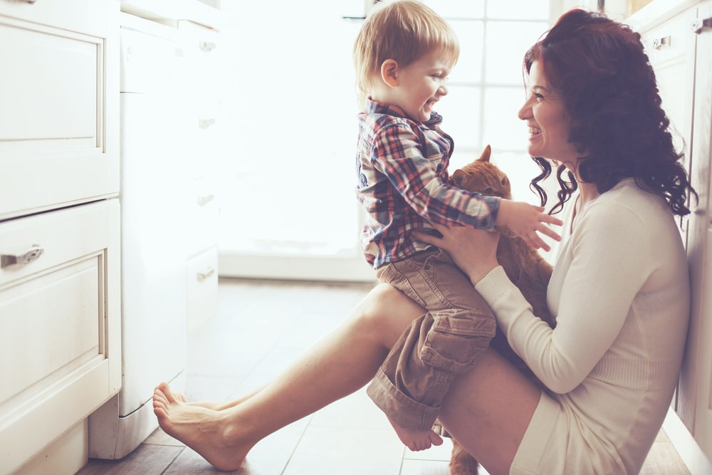 mother and son happy on kitchen
