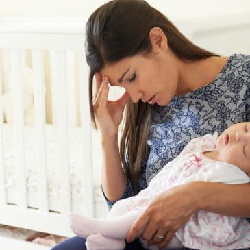 woman tired with baby