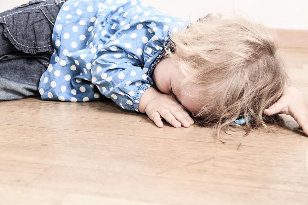 little girl sad on floor