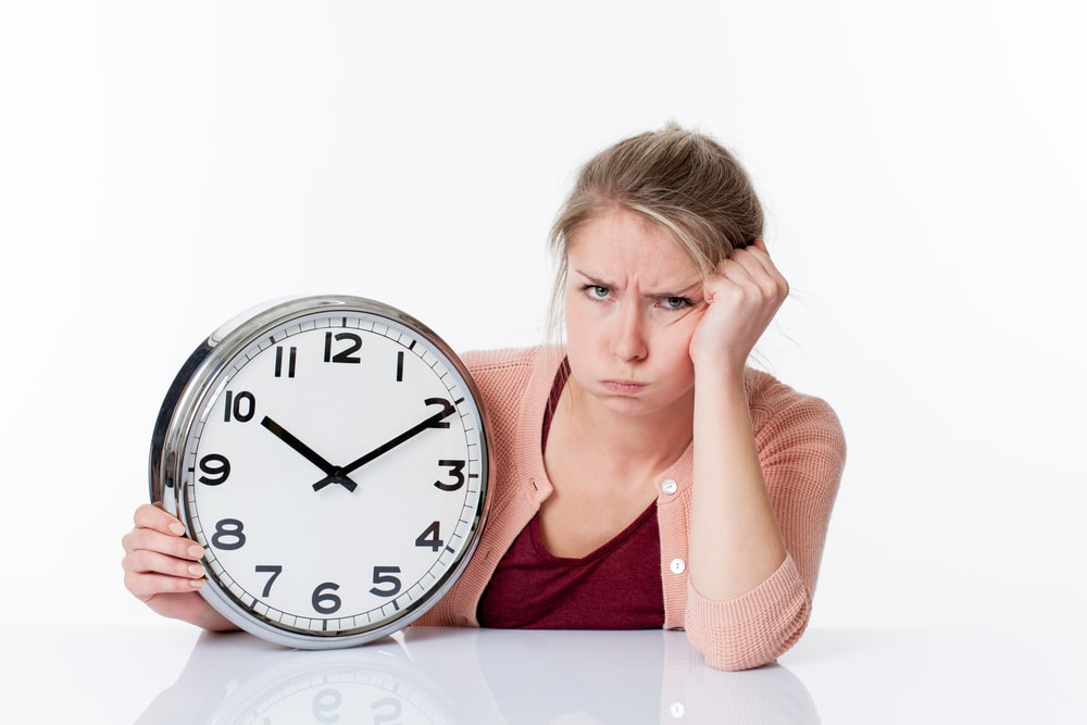 woman tired with clock