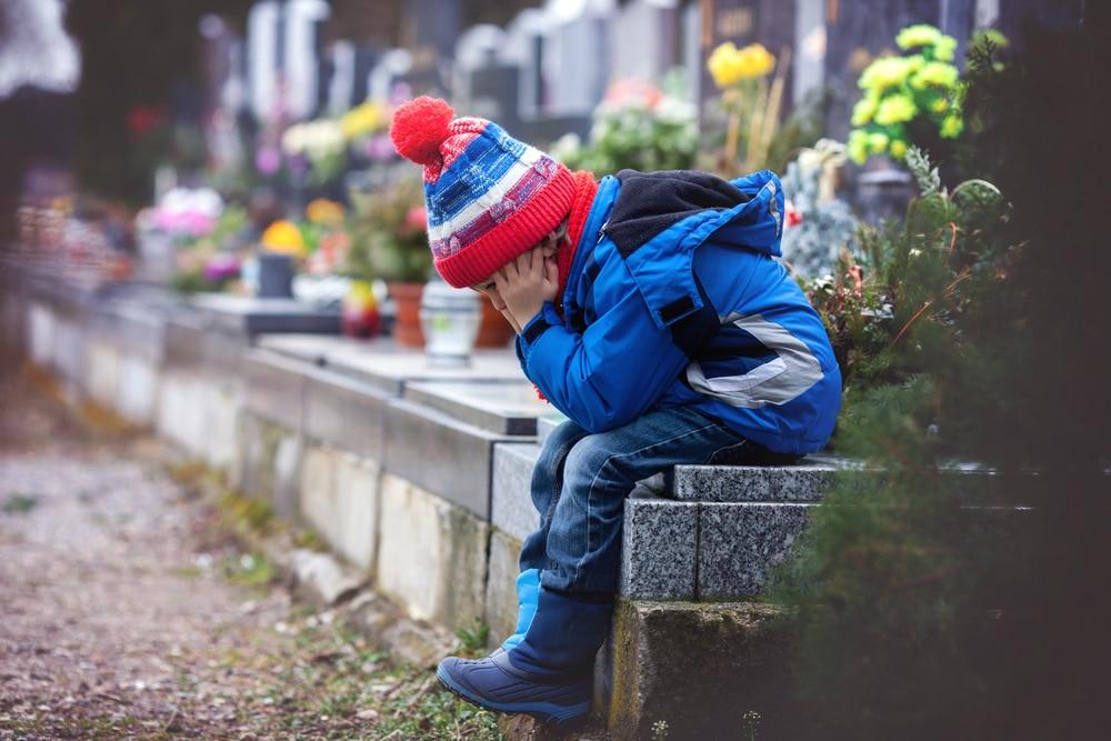 kid in cimetery