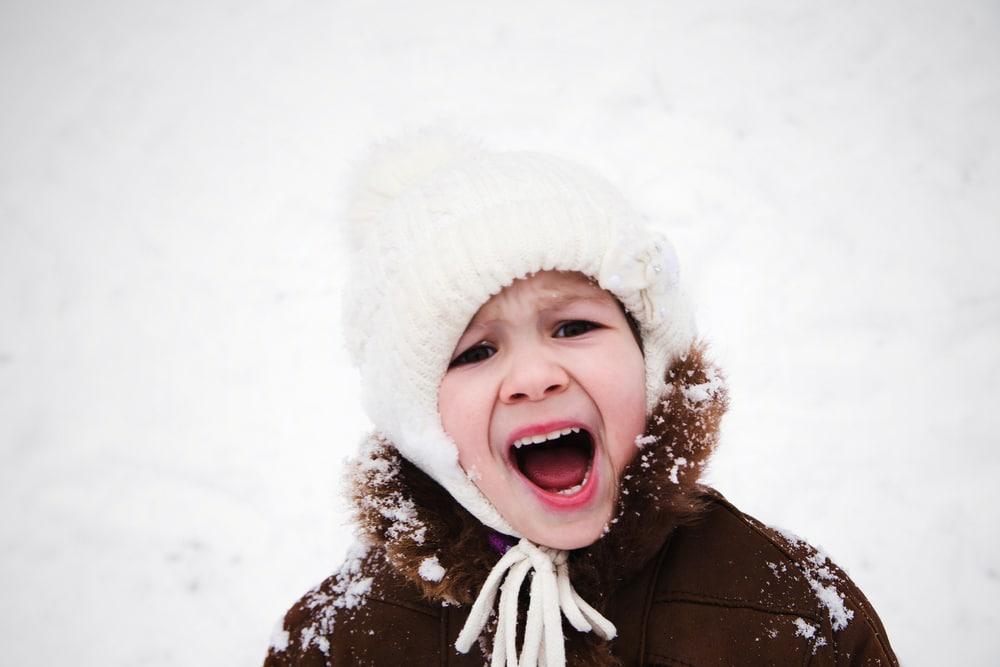 little girl in winter yell