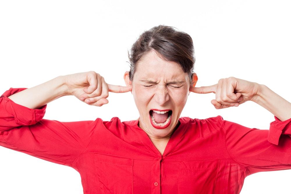 woman close ears