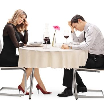 couple romantic dinner unhappy