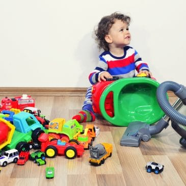 kid play with mess of toys vacuum