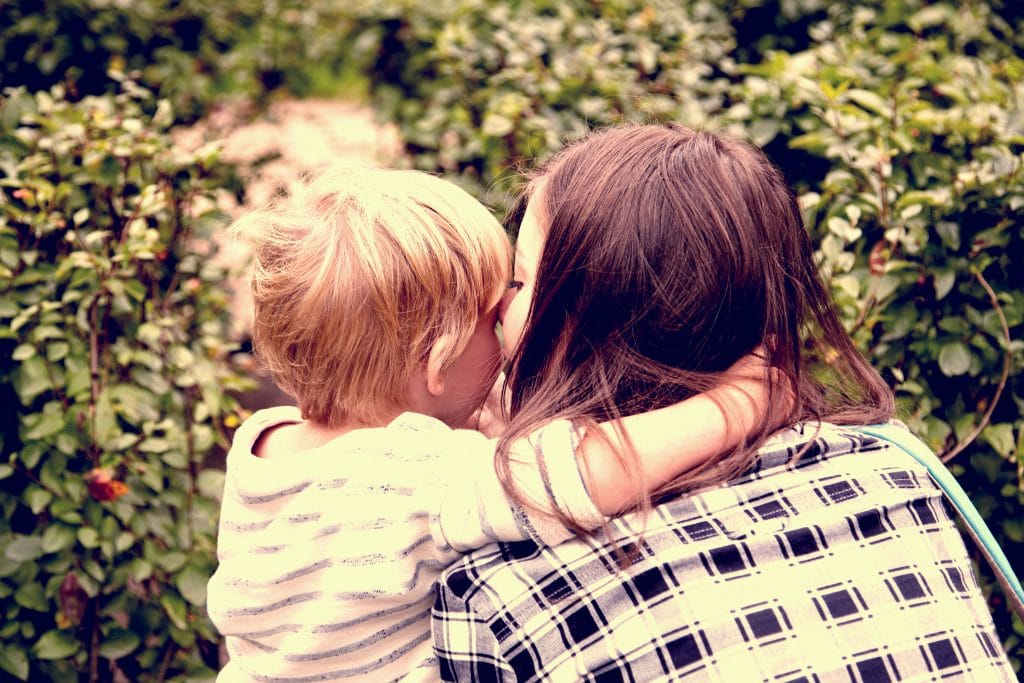 woman with son back kiss