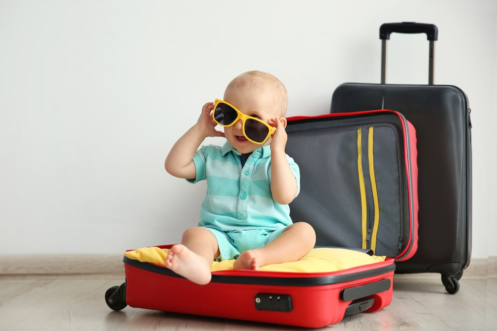 baby glass and suitcase