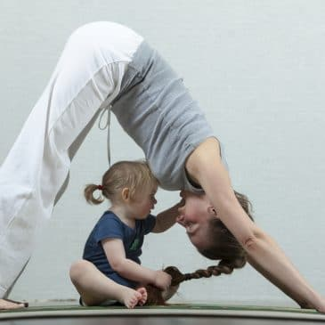 woman yoga with kid