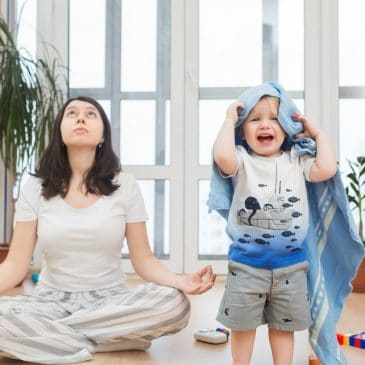 woman trying meditate with kid