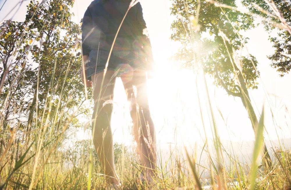 woman walking on sun