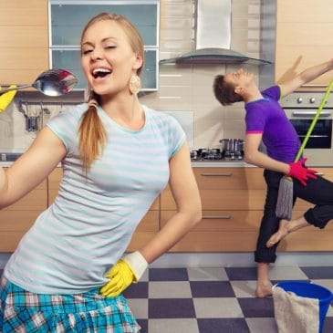couple playing cleaning