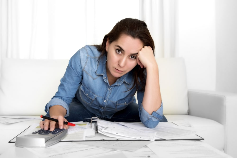 woman with calculator stressed