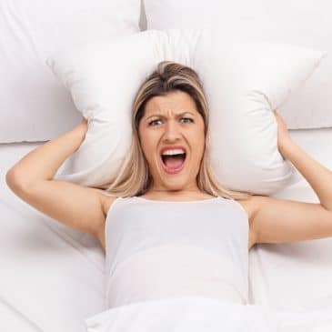 woman in bed angry