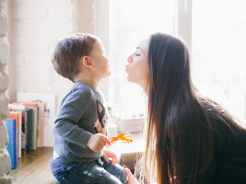 mother with kid kiss