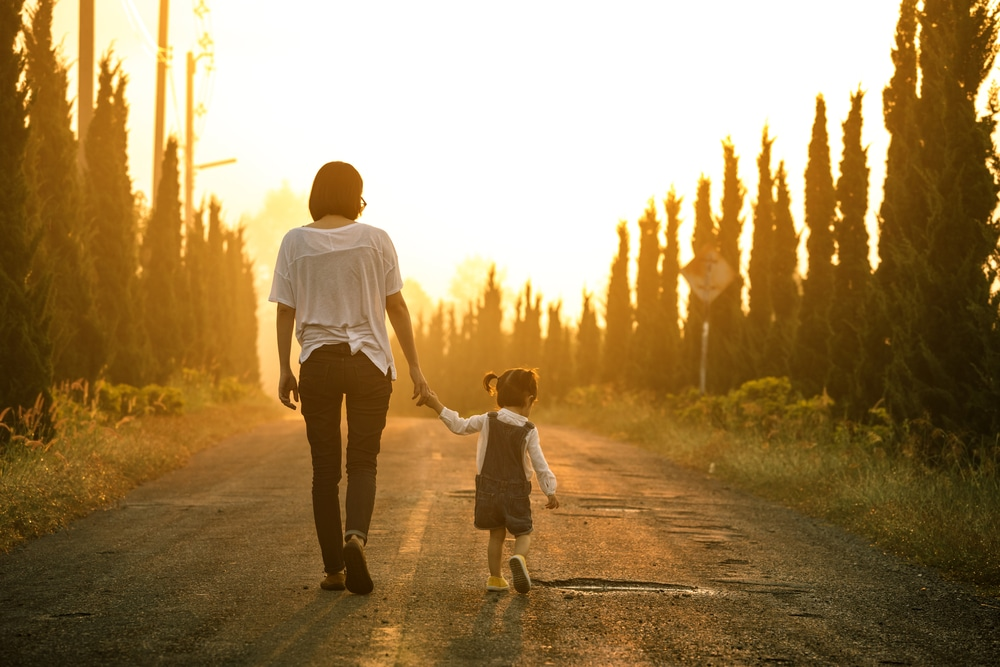 mother walking with daughter