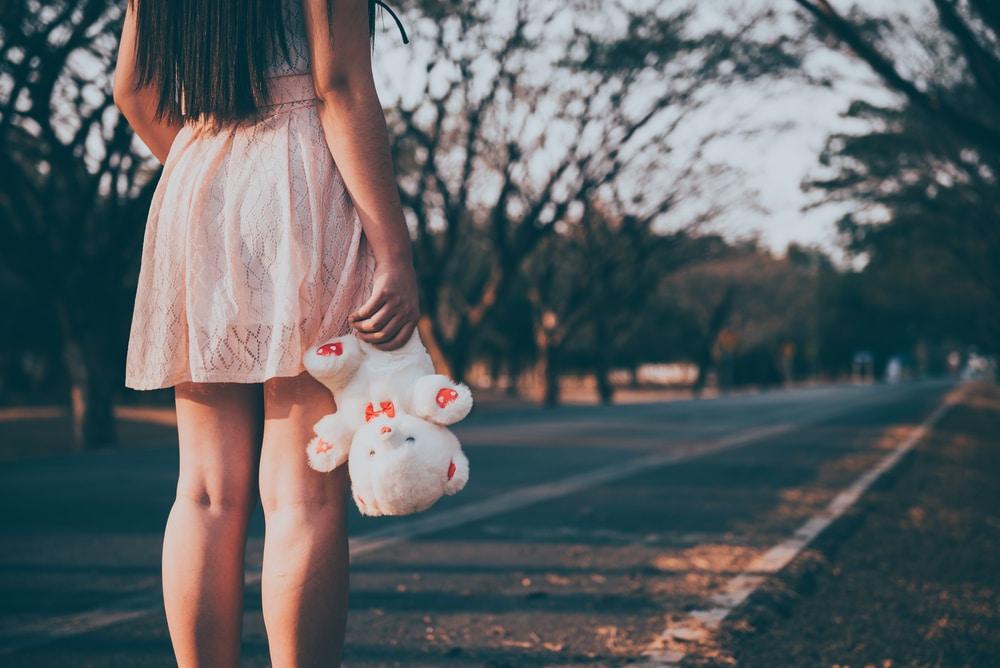 little girl alone in the street