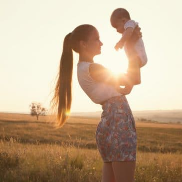 woman with baby sun