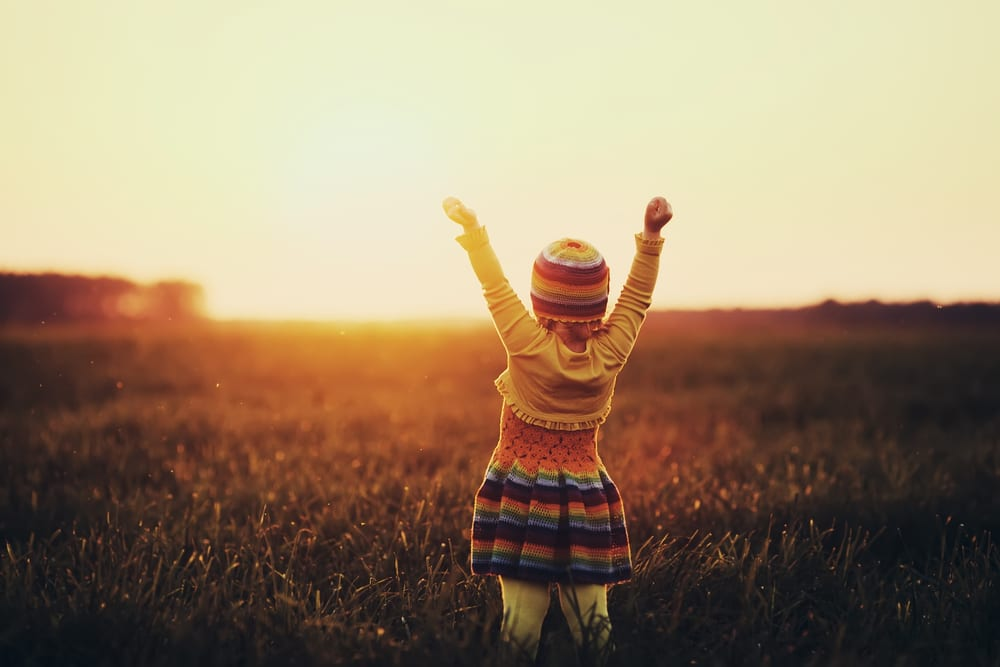 little girl in a field on spring