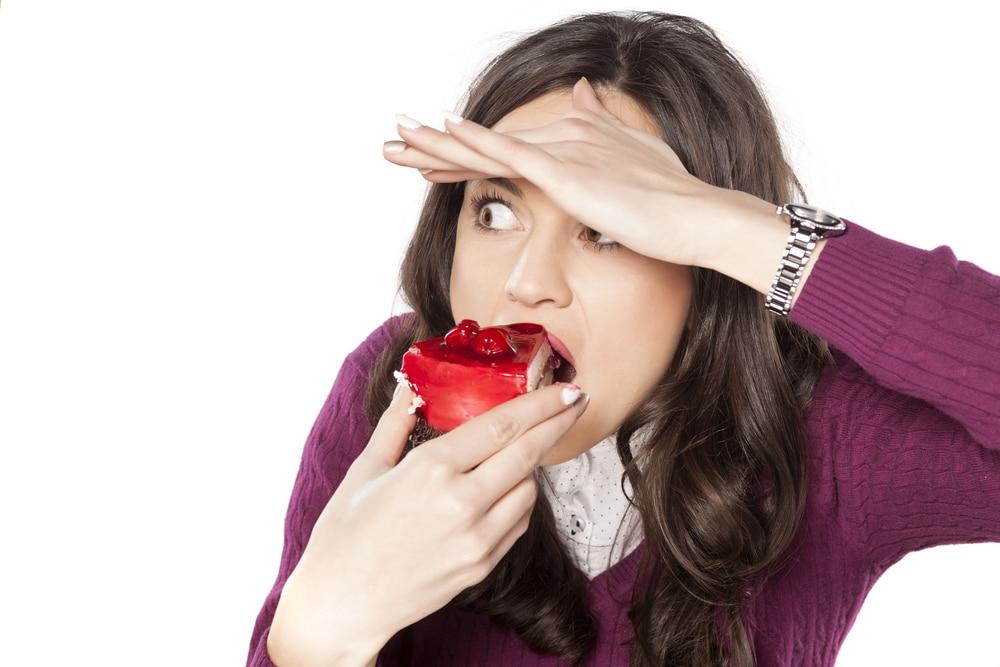 woman hiding eat