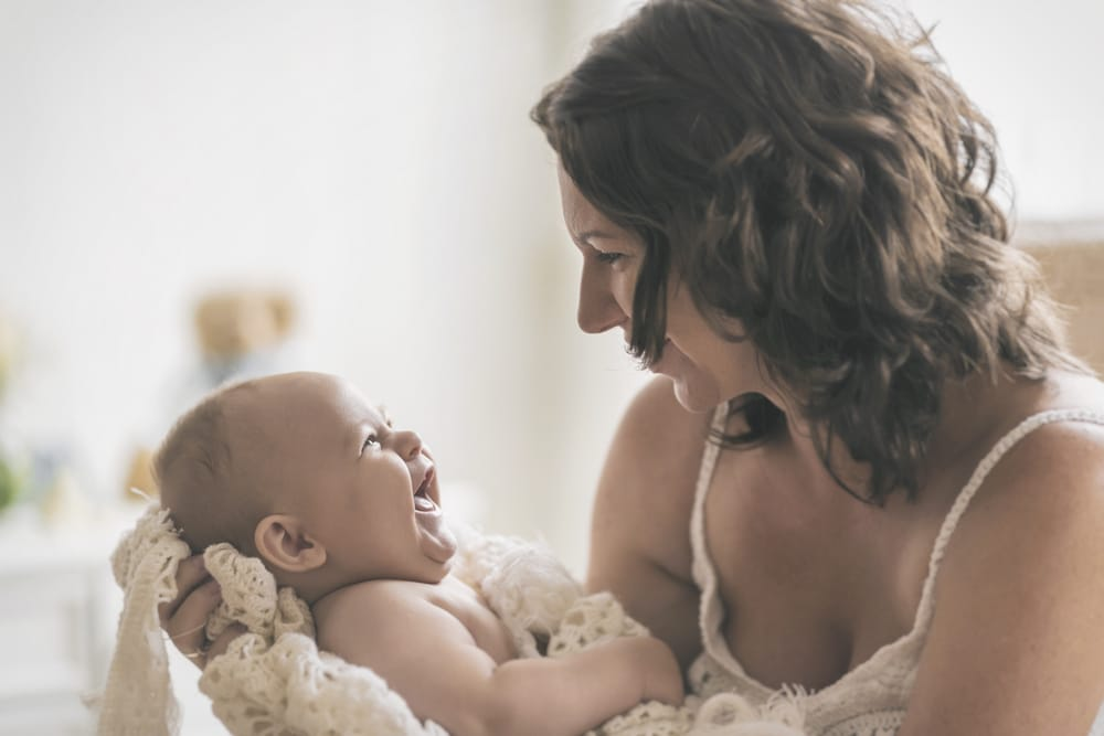 woman laugh with baby