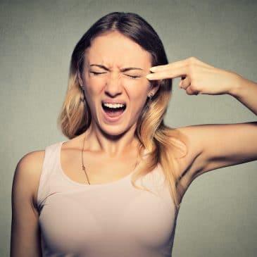 woman gun gesture