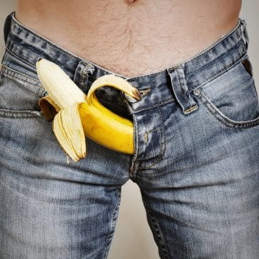 man with jeans and banana