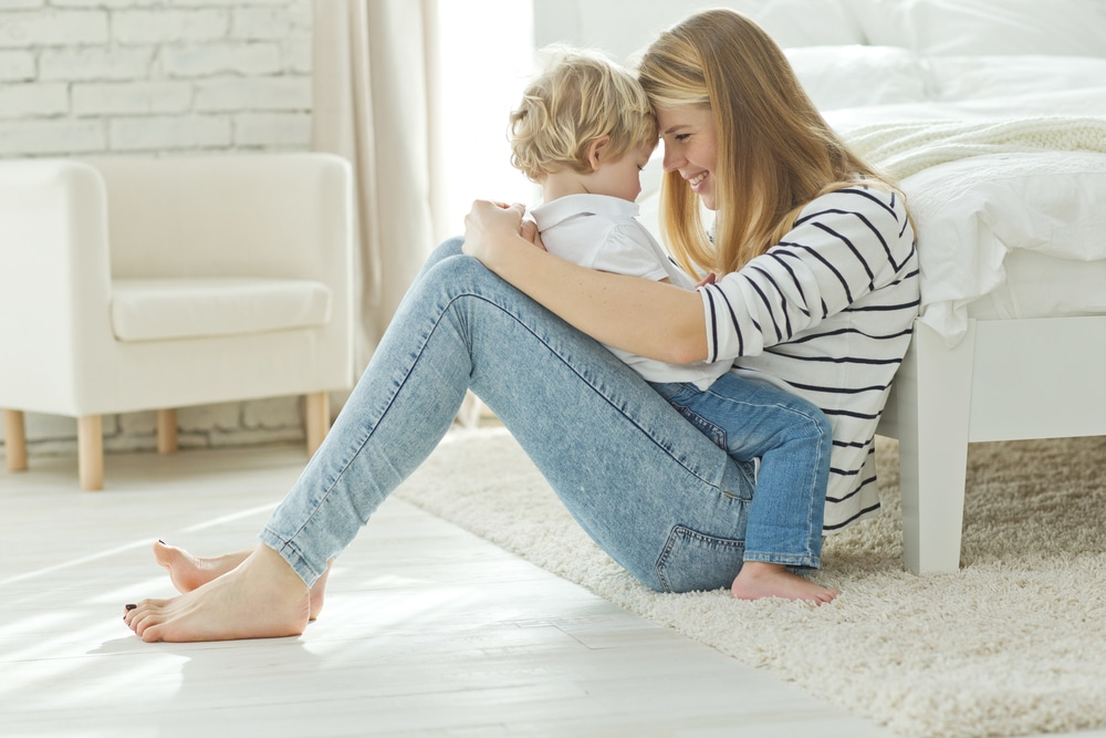 woman with son in bedroom